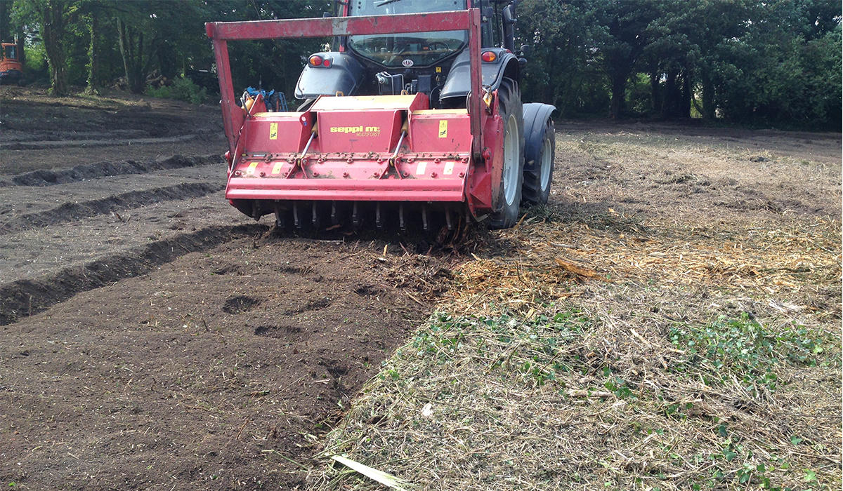 Mulching in readiness for a lawn, Cardiff