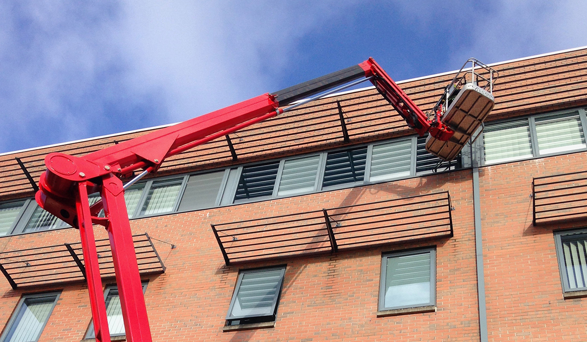 Cherry picker hire for building maintenance to South Wales Police Station, Cardiff Bay